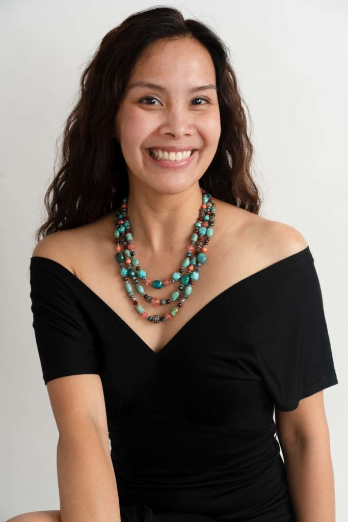 woman wearing beaded necklace